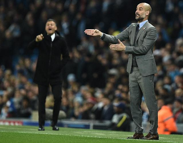 Manchester City manager Pep Guardiola (right) and Barcelona coach Luis Enrique shout instructions from the touchline during their Champions League match at the Etihad Stadium on November 1, 2016 (AFP Photo/Oli Scarff)