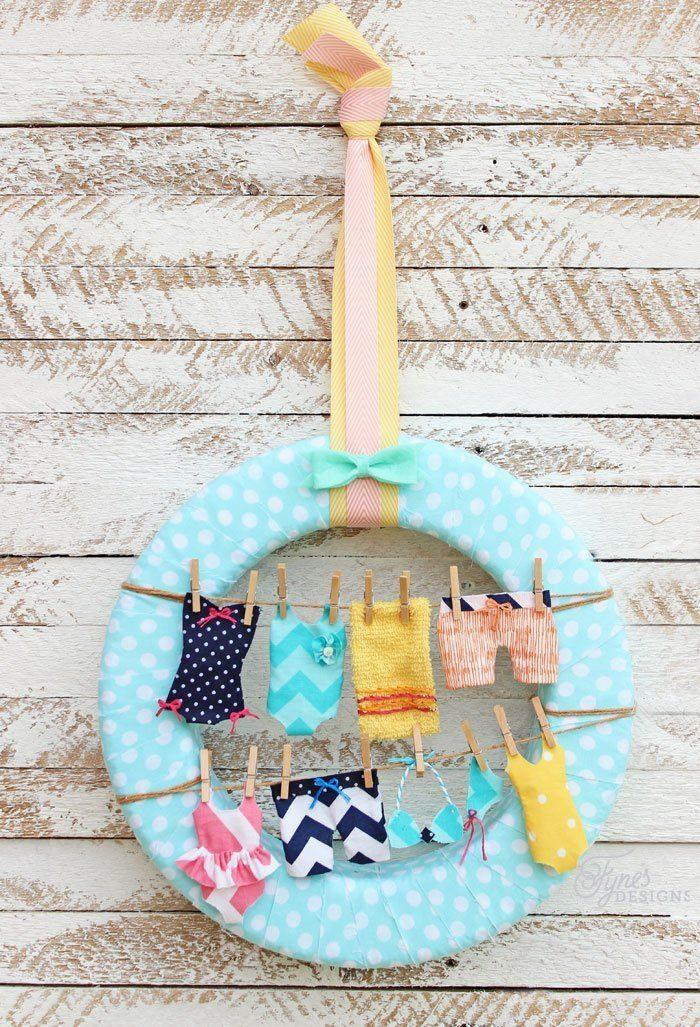 "<p>Wrap the best summer motifs into one adorably festive door decoration, with mini swimsuits, clothesline, and pretty pastels. Pool party, anyone?</p><p><strong>Get the tutorial at <a href=""https://www.fynesdesigns.com/summer-wreath-idea-swimsuits-clothesline/"" rel=""nofollow noopener"" target=""_blank"" data-ylk=""slk:Fynes Designs"" class=""link rapid-noclick-resp"">Fynes Designs</a>.</strong></p><p><a class=""link rapid-noclick-resp"" href=""https://www.amazon.com/Carousel-Designs-White-Polka-Fabric/dp/B01DWO7C6A/?tag=syn-yahoo-20&ascsubtag=%5Bartid%7C10050.g.4395%5Bsrc%7Cyahoo-us"" rel=""nofollow noopener"" target=""_blank"" data-ylk=""slk:SHOP FABRIC"">SHOP FABRIC</a></p>"