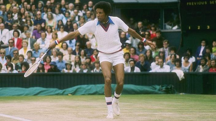 US tennis player Arthur Ashe playing at Wimbledon in London, the UK