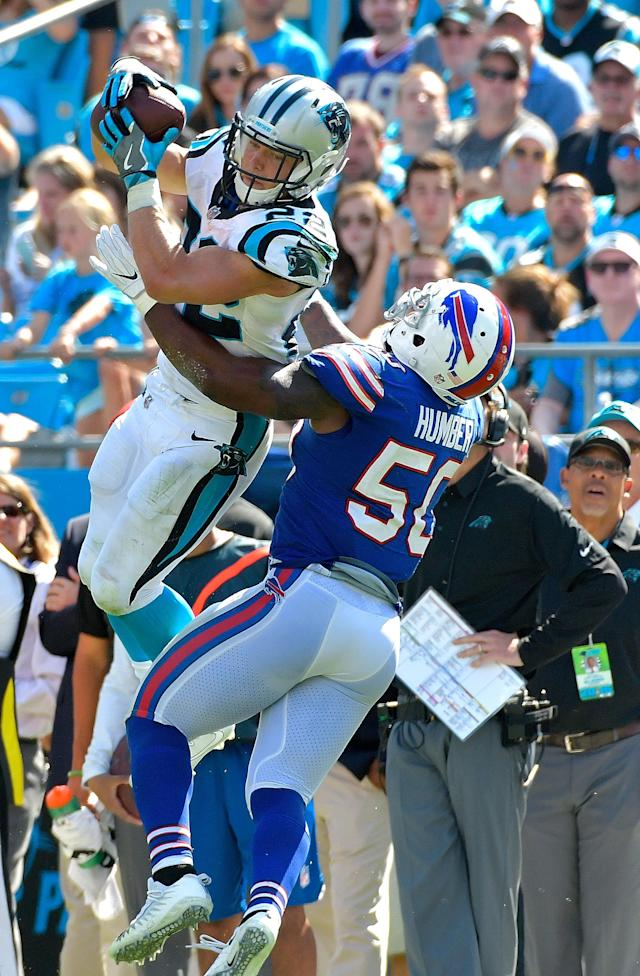 <p>Christian McCaffrey #22 of the Carolina Panthers makes a catch against Ramon Humber #50 of the Buffalo Bills during their game at Bank of America Stadium on September 17, 2017 in Charlotte, North Carolina. (Photo by Grant Halverson/Getty Images) </p>