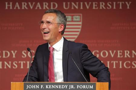 Norway's PM Stoltenberg laughs while listening to a question from the audience following his speech at the Kennedy School of Government at Harvard University in Cambridge