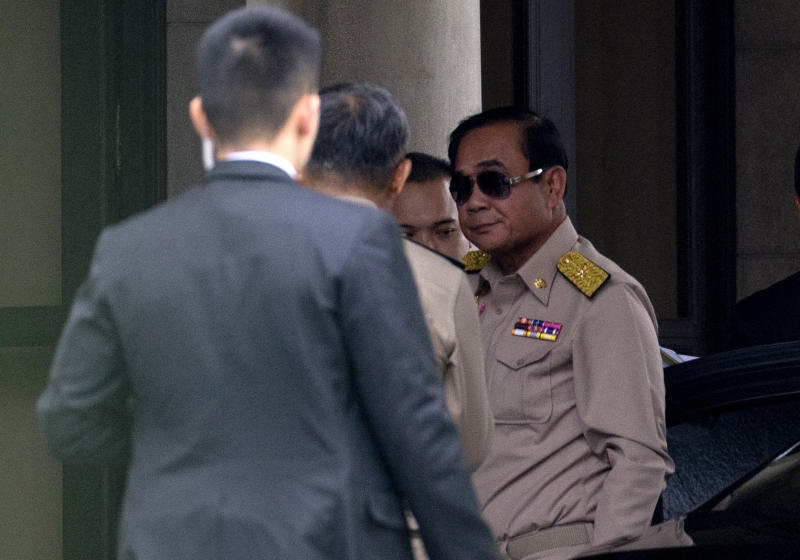 Thai Prime Minister Prayuth Chan-ocha, right, arrives at Government house in Bangkok, Thailand, Monday, March 26, 2019. A military-backed party has taken the lead in Thailand's first election since a 2014 coup, preliminary results showed, suggesting junta leader and Prime Minister Prayuth Chan-ocha could stay in power, helped by an electoral system tilted in the military's favor.(AP Photo/Sakchai Lalit)