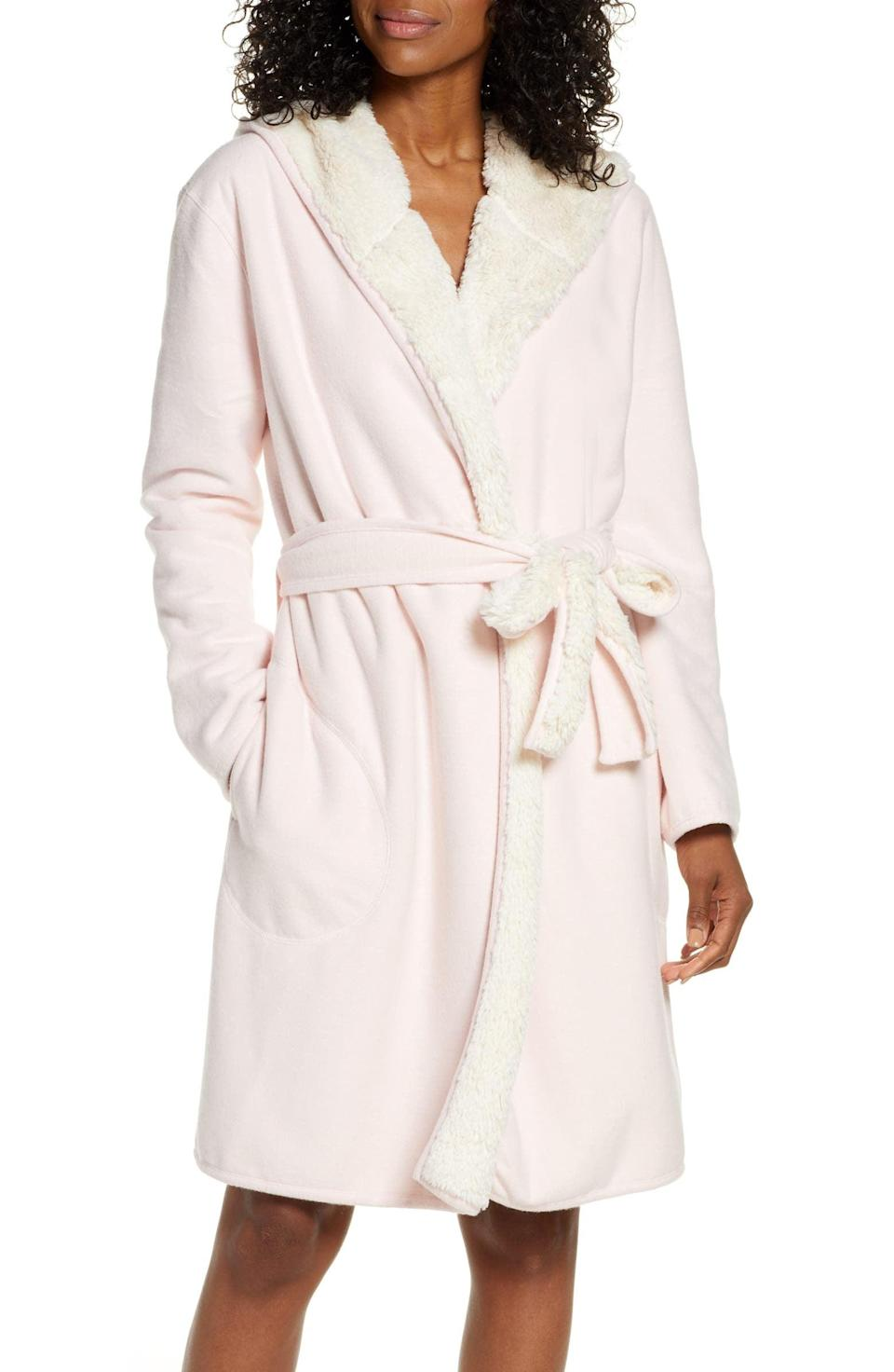 <p>Get this <span>UGG Portola Reversible Hooded Robe</span> ($148) for the person who loves fluffy stuff.</p>