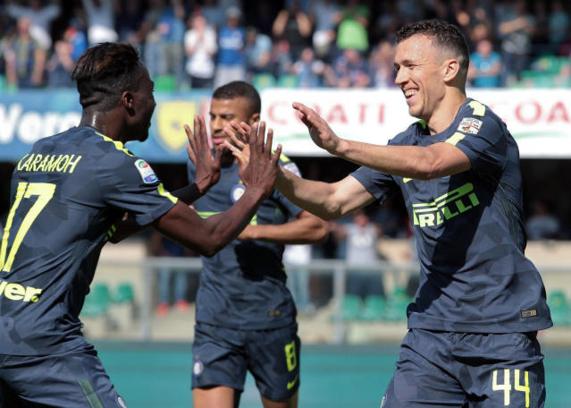 Inter's Ivan Perisic, right, celebrates with his teammate Yann Karamoh after he scored during a Serie A soccer match between Chievo and Inter Milan at the Bentegodi stadium in Verona, Sunday, April 22, 2018. (Filippo Venezia/ANSA via AP)