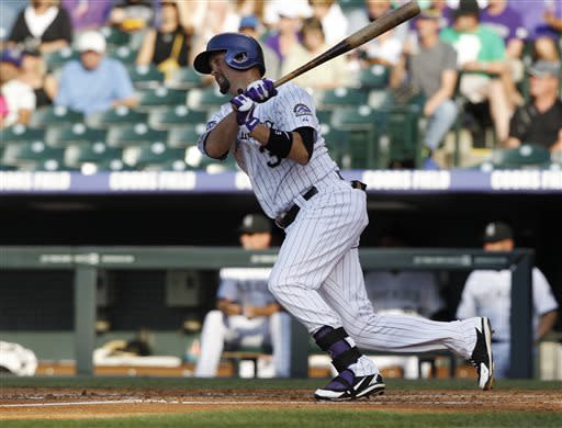 Colorado Rockies' Michael Cuddyer singles against the Los Angeles Dodgers in the first inning of a baseball game in Denver, Wednesday, July 3, 2013. Cuddyer's 27-game hitting streak ended on Tuesday night against the Dodgers. (AP Photo/David Zalubowski)
