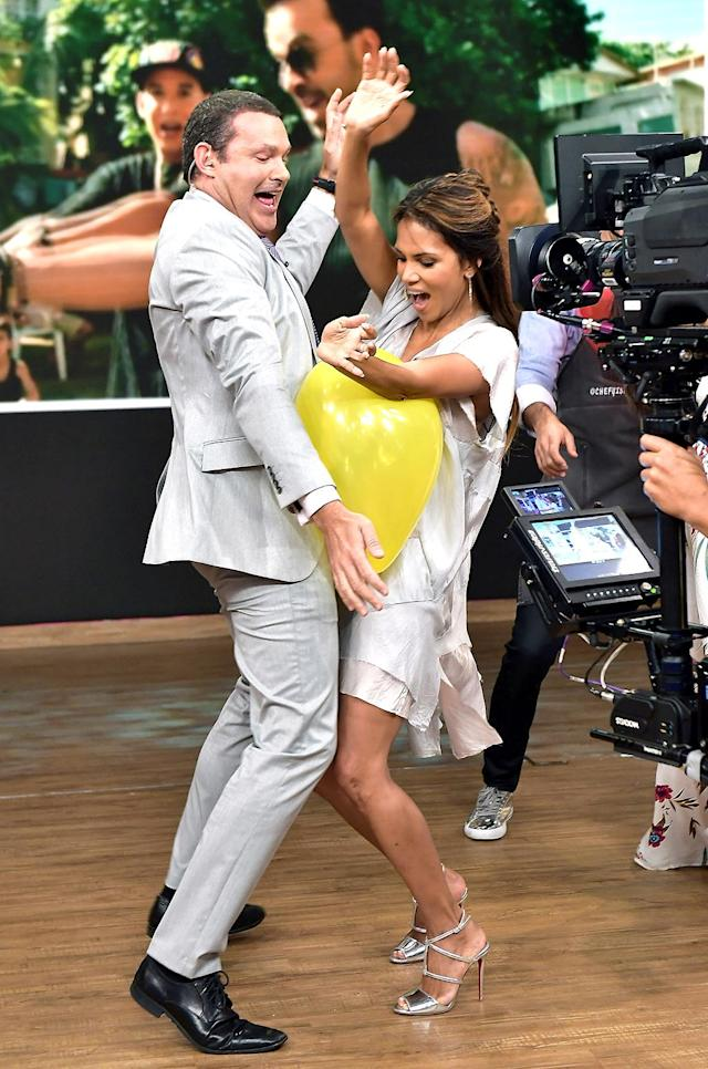 <p>On <i>Despierta America</i>, Berry really got up close and personal with host Alan Tacher. The two played a game where they had to keep a balloon in the air without using their hands. (Photo: Gustavo Caballero/Getty Images) </p>