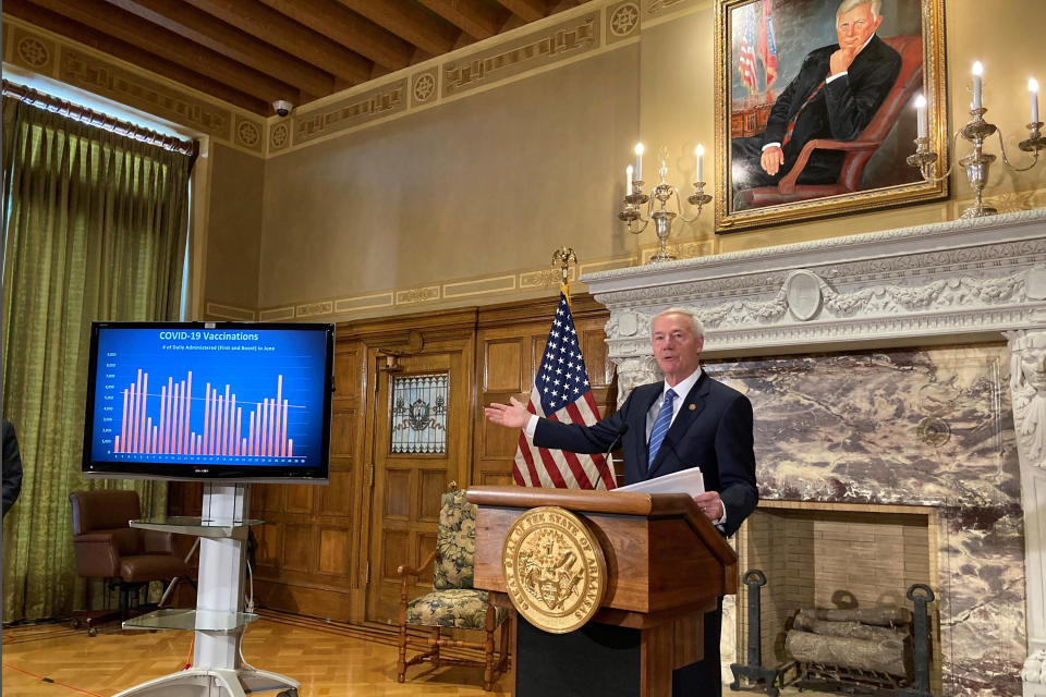 Arkansas Gov. Asa Hutchinson talks about COVID-19 vaccinations at the state Capitol in Little Rock, Ark., on Tuesday, June 29, 2021. Hutchinson, a Republican, has been in the national spotlight this year as he heads into the final half of his last term in office. (AP Photo/Andrew Demillo)