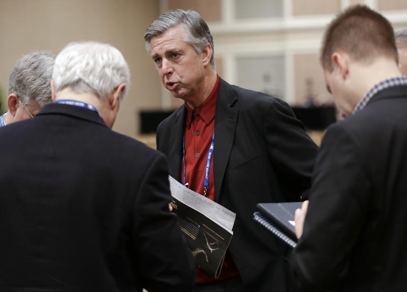 Detroit Tigers general manager David Dombrowski, center, talks with reporters following the Rule 5 draft at the baseball winter meetings on Thursday, Dec. 6, 2012, in Nashville, Tenn. (AP Photo/Mark Humphrey)