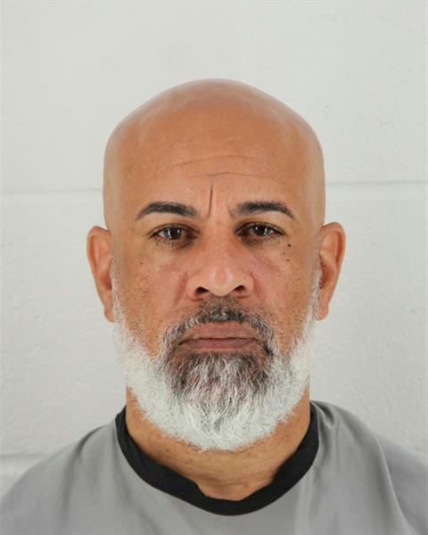 In this photo provided by the Johnson County, Kansas Sheriff's Office, Charles Pearson is pictured in a booking photo dated Oct. 8, 2018. Kansas City, Kansas, police have identified Pearson as the man they fatally shot near a popular shopping area after he said he had killed his wife. (Johnson County, Kansas Sheriff's Office via AP)