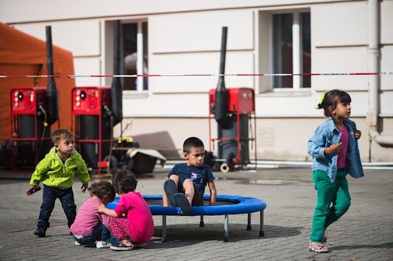 Refugee children play in the courtyard of their shelter for asylum-seekers at the former Wilmersdorf town hall in Berlin on August 26, 2015 (AFP Photo/Odd Andersen)