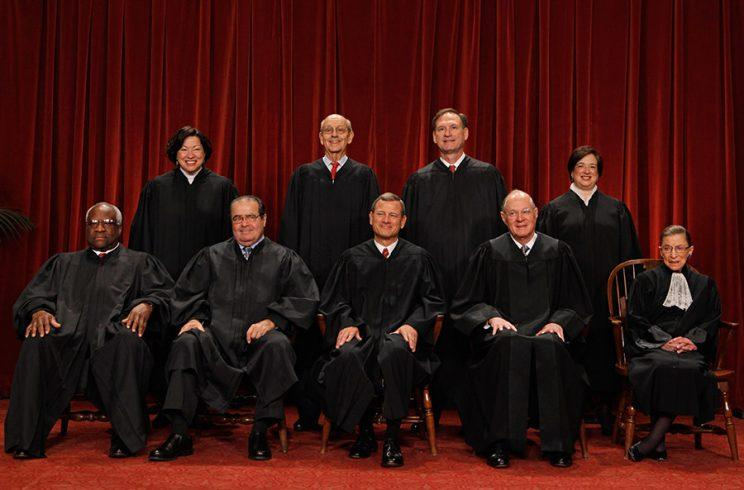 U.S. Supreme Court members (first row L-R) Associate Justice Clarence Thomas, Associate Justice Antonin Scalia, Chief Justice John Roberts, Associate Justice Anthony Kennedy, Associate Justice Ruth Bader Ginsburg, (back row L-R) Associate Justice Sonia Sotomayor, Associate Justice Stephen Breyer, Associate Justice Samuel Alito and Associate Justice Elena Kagan pose for photographs in the East Conference Room at the Supreme Court building October 8, 2010 in Washington, DC. This is the first time in history that three women are simultaneously serving on the court. (Photo: Getty Images)