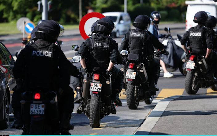 Police officers travel to the Intercontinental Hotel, Geneva, where Joe Biden is to arrive on Tuesday ahead of his summit with Vladimir Putin - Sean Gallup/Getty Images Europe