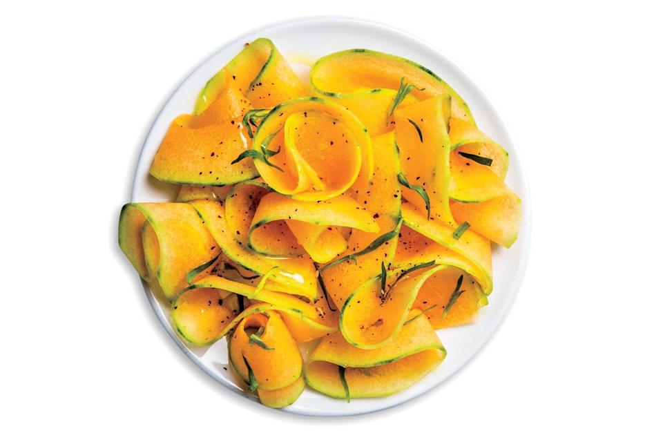 """When shopping for this salad at the market, pick heavy, aromatic cantaloupes with stem ends that yield slightly when pressed. <a href=""""https://www.epicurious.com/recipes/food/views/savory-shaved-cantaloupe-salad?mbid=synd_yahoo_rss"""" rel=""""nofollow noopener"""" target=""""_blank"""" data-ylk=""""slk:See recipe."""" class=""""link rapid-noclick-resp"""">See recipe.</a>"""