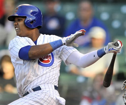 Chicago Cubs' Starlin Castro watches his single during the fourteenth inning of an MLB baseball game against the Cincinnati Reds in Chicago, Thursday, June 13, 2013. Chicago won 6-5 in fourteen innings. (AP Photo/Paul Beaty)