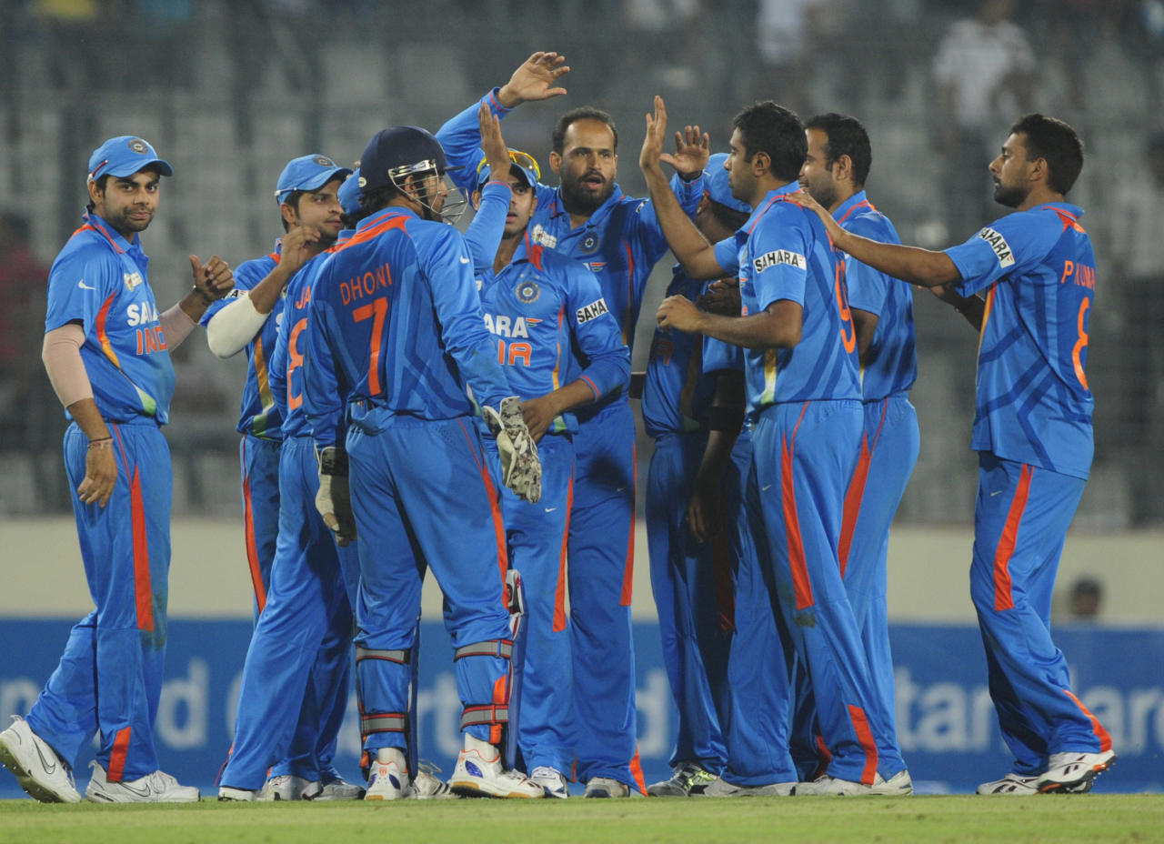 Indian cricketers celebrate the dismissal of Sri Lankan cricketer Kumar Sangakkara during the one day international (ODI) Asia Cup cricket match between India and Sri Lanka at The Sher-e-Bangla National Cricket Stadium in Dhaka on March 13, 2012. AFP PHOTO/Munir uz ZAMAN (Photo credit should read MUNIR UZ ZAMAN/AFP/Getty Images)