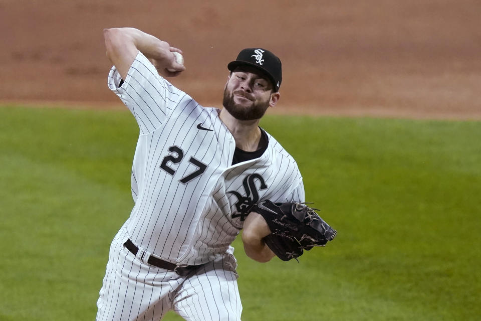 FILE - In this Friday, Sept. 11, 2020 file photo, Chicago White Sox starting pitcher Lucas Giolito delivers during the first inning of the team's baseball game against the Detroit Tigers in Chicago. Lucas Giolito, Max Fried and Jack Flaherty were teammates nine years ago at Harvard-Westlake, a prestigious prep school in Los Angeles. On Thursday, April 1, 2021, all three will be opening day starting pitchers in the major leagues. (AP Photo/Charles Rex Arbogast, File)