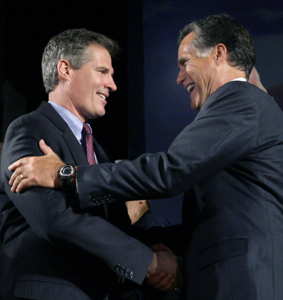 In this photo taken Jan. 19, 2010, former Massachusetts Gov. and presidential hopeful, Mitt Romney, right, introduces and congratulates U.S. Senator-elect Scott Brown, R-Mass. at his Boston victory party after he won the seat vacated by the late Sen. Edward Kennedy. The two Massachusetts Republicans have a history of supporting each other throughout their political careers, but facing tough elections neither is playing up that history now, perhaps with good reason. (AP Photo/Elise Amendola)