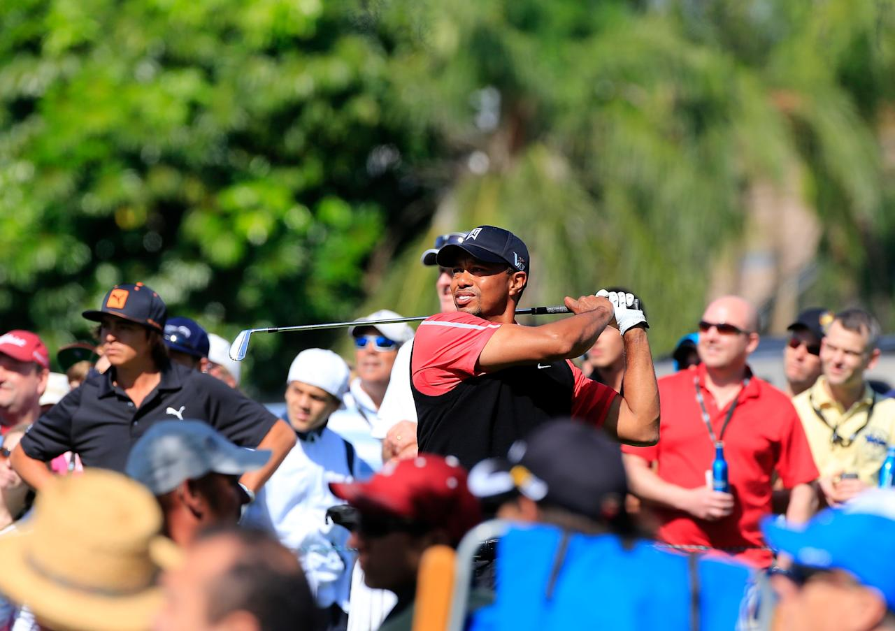 ORLANDO, FL - MARCH 25:  Tiger Woods plays a shot on the 8th hole during the final round of the Arnold Palmer Invitational presented by MasterCard at the Bay Hill Club and Lodge on March 25, 2013 in Orlando, Florida.  (Photo by Sam Greenwood/Getty Images)