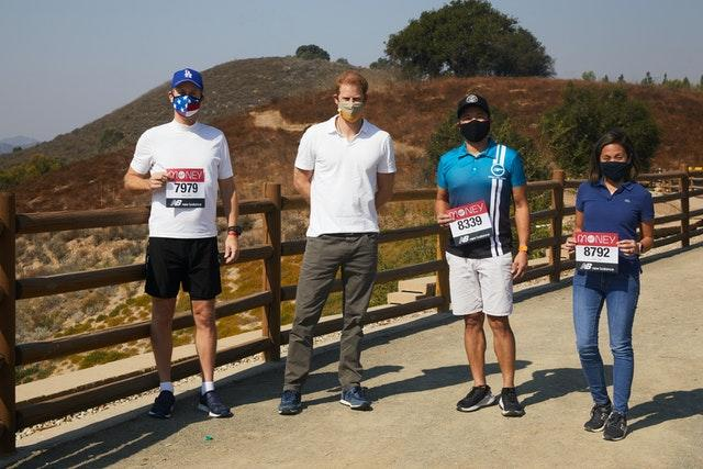 The Duke of Sussex, Patron of the London Marathon Charitable Trust, poses with runners in Los Angeles before they take on the virtual Virgin Money London Marathon