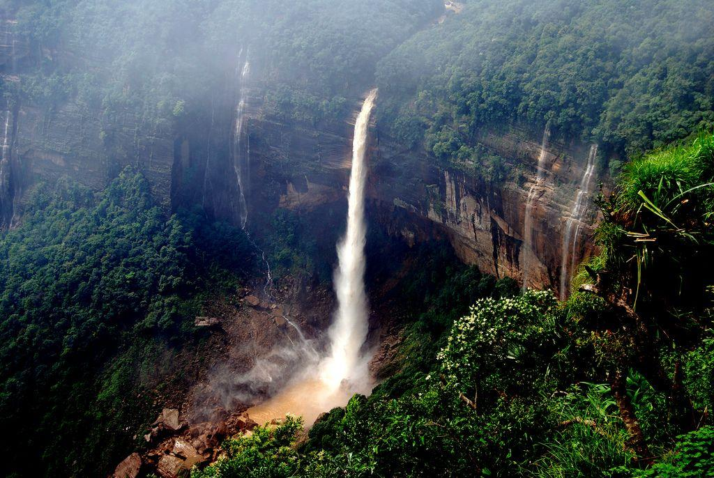 "Nohkalikai Falls, Cherrapunjee, India. Cherrapunjee in India's northeastern state of Meghalaya is notable as the place that receives the highest rainfall in the country. This is also the highest waterfall in India. It plunges 335 metres (1100 feet).<br>by <a target=""_blank"" href=""https://www.flickr.com/photos/10313433@N08/"">Dipak Paul</a>/ Flickr"