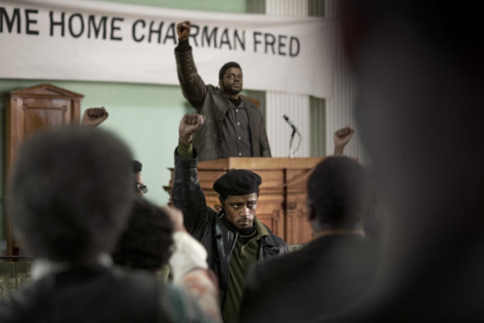 """This image released by Warner Bros. Pictures shows LaKeith Stanfield, foreground, and Daniel Kaluuya in a scene from the upcoming film """"Judas and the Black Messiah."""" Warner Bos. Pictures on Thursday announced that all of its 2021 film slate will stream on HBO Max at the same time they play in theaters. (Glen Wilson/Warner Bros. Entertainment via AP)"""