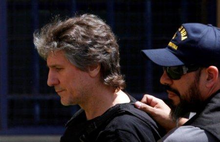 FILE PHOTO: Former Argentine Vice President Amado Boudou is escorted by a member of Argentina's Coastguards as he arrives to a Federal Justice building in Buenos Aires, Argentina November 3, 2017. REUTERS/Martin Acosta