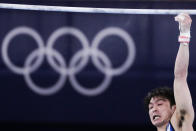 Japan's Kohei Uchimura falls from the horizontal bar during the men's artistic gymnastic qualifications at the 2020 Summer Olympics, Saturday, July 24, 2021, in Tokyo. (AP Photo/Ashley Landis)