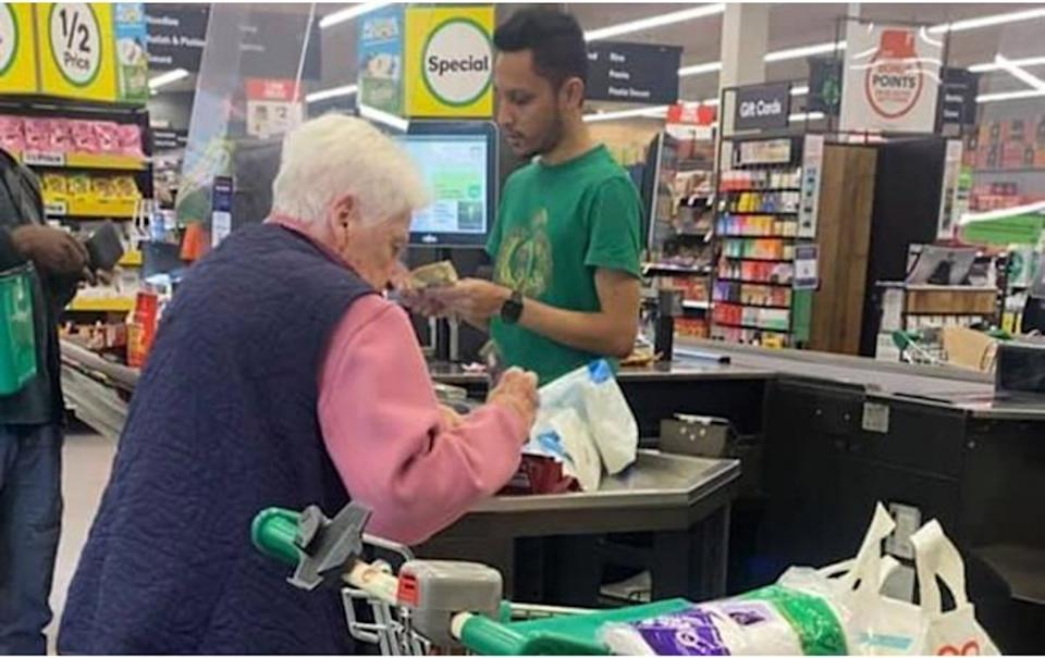 An elderly woman at a Woolworths checkout. Source: Facebook