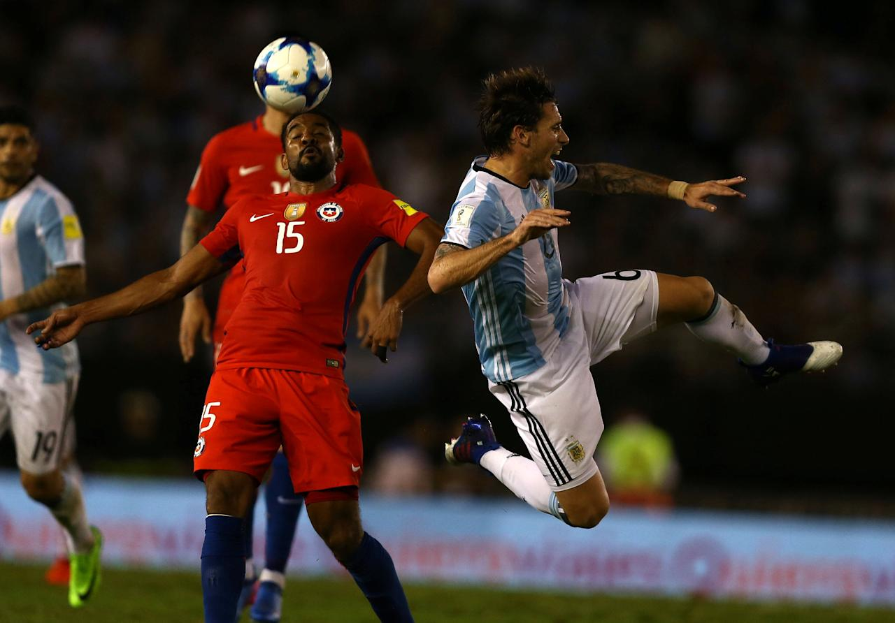Football Soccer - Argentina v Chile - World Cup 2018 Qualifiers - Antonio Liberti Stadium, Buenos Aires, Argentina - 23/3/17 - Argentina's Lucas Biglia (R) and Chile's Jean Beausejour in action. REUTERS/Marcos Brindicci