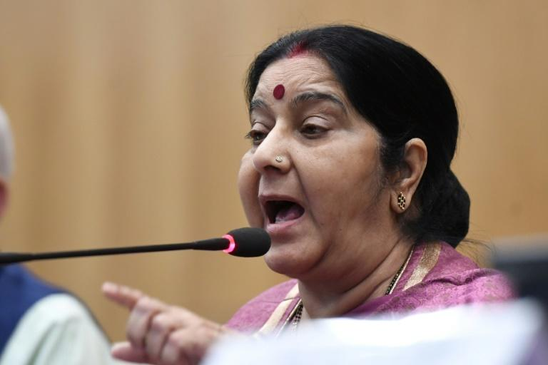 Indian External Affairs Minister Sushma Swaraj addresses a press conference on the murdered workers
