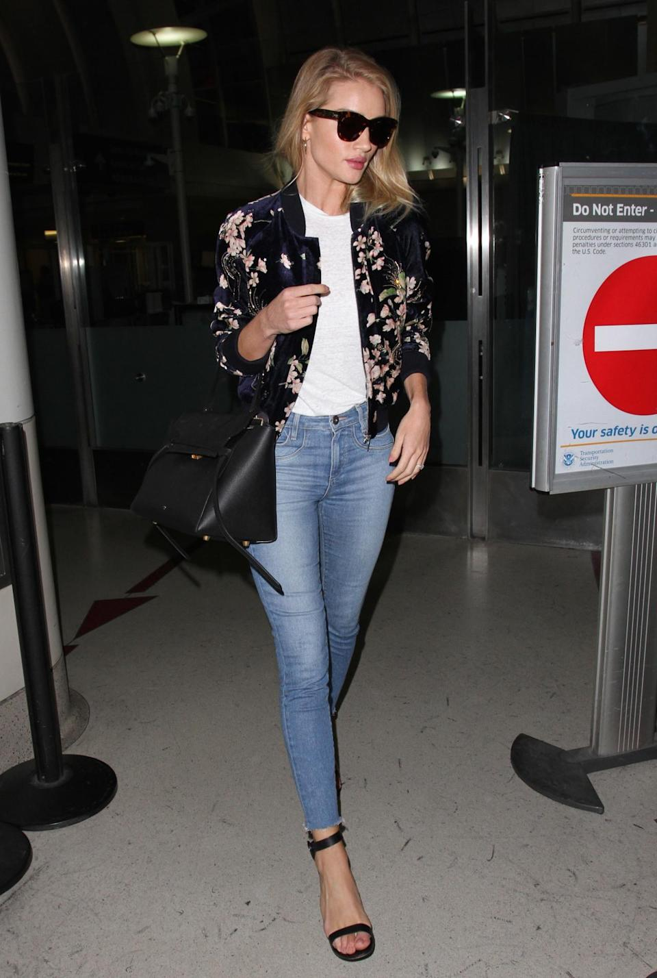 <p>Skinny jeans, strappy heels, a floral bomber and the latest It bag? RHW <i>really </i>knows how to do airport style. <i>(Photo by Splash News)</i></p>