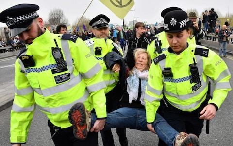 Police officers imposed an order allowing activists to protest only within Marble Arch - Credit: DANIEL LEAL-OLIVAS/AFP