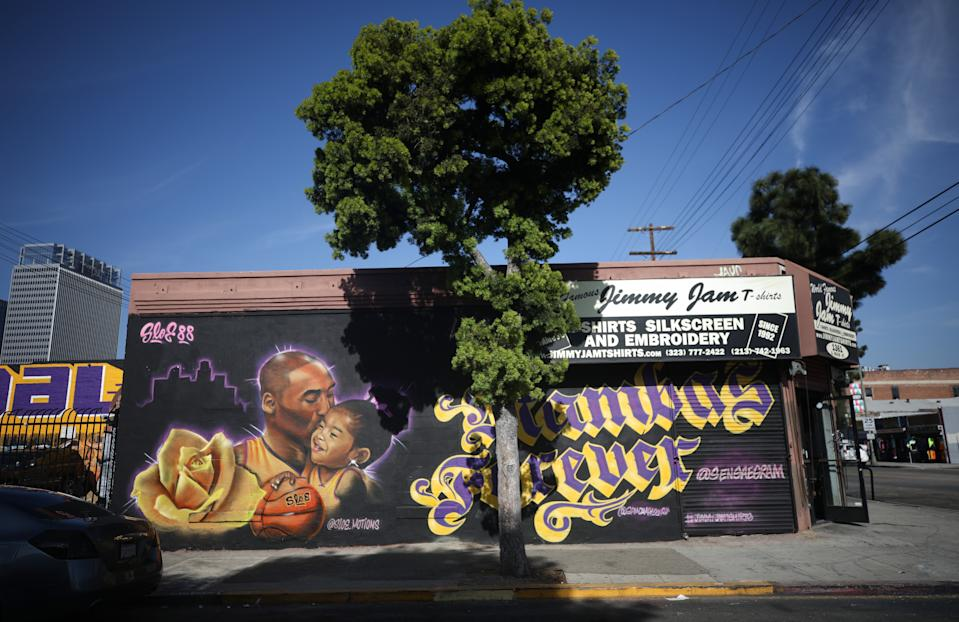 A mural depicting deceased NBA star Kobe Bryant and his daughter Gianna, painted by @sloe_motions, is displayed on a building in Los Angeles. (Mario Tama/Getty Images)