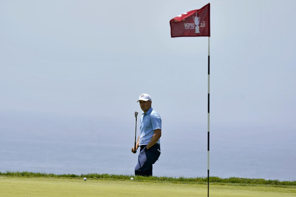 Jordan Spieth watches his shot on the 14th green during a practice round of the U.S. Open Golf Championship, Tuesday, June 15, 2021, at Torrey Pines Golf Course in San Diego. (AP Photo/Marcio Jose Sanchez)
