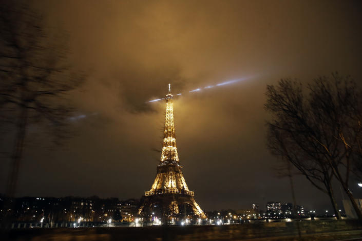 The Eiffel Tower is pictured during the curfew in Paris, Saturday, Jan.16, 2021. All of France is under a stricter curfew starting Saturday at 6 p.m. for at least 15 days to fight the spread of the coronavirus. (AP Photo/Christophe Ena)