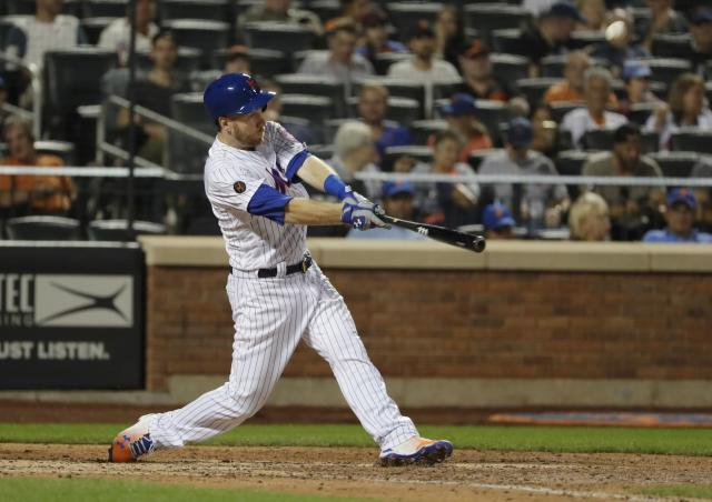 New York Mets' Todd Frazier hits a home run during the seventh inning of the team's baseball game against the San Francisco Giants on Wednesday, Aug. 22, 2018, in New York. (AP Photo/Frank Franklin II)