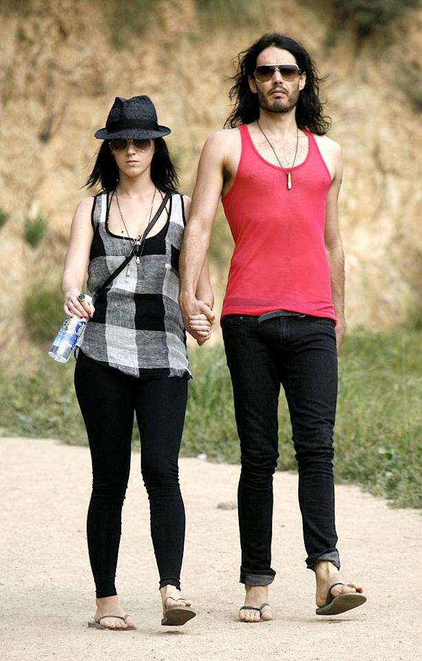 """Katy Perry and Russell Brand went hiking on Sunday in LA's Griffith Park, where they also paid a visit to the famed observatory. Next time the lovebirds decide to get sporty, they might want to consider wearing something other than flip flops! <a href=""""http://www.x17online.com"""" target=""""new"""">X17 Online</a> - March 21, 2010"""