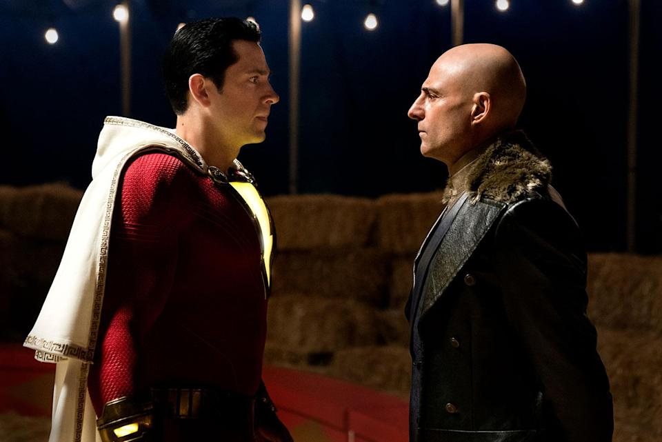 """(L-R) ZACHARY LEVI as Shazam and MARK STRONG as Dr. Thaddeus Sivana in New Line Cinema's action adventure """"SHAZAM!,"""" a Warner Bros. Pictures release. (© 2019 WARNER BROS. ENTERTAINMENT INC.)"""