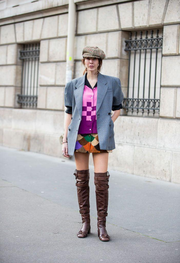 <p>A graphic top with a fish-scale patterned skirt are both tied together with a gray blazer over the two. Add a newsboy cap that complements your dark brown boots, and you'll have the cutest fall outfit. </p>