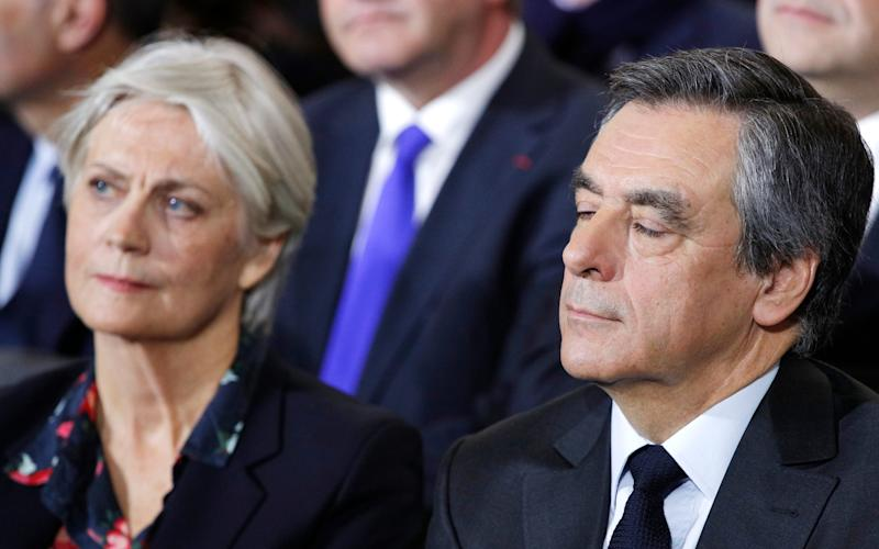 Conservative presidential candidate Francois Fillon and his wife Penelope attend a campaign meeting in Paris - Credit: Christophe Ena/AP