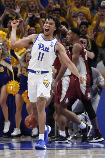 Pittsburgh's Justin Champagnie (11) celebrates as Florida State's Devin Vassell (24) and Anthony Polite (2) leave the court after an NCAA college basketball game Wednesday, Nov. 6, 2019, in Pittsburgh. Pittsburgh won 63-61. (AP Photo/Keith Srakocic)