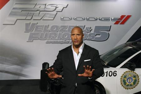 """Actor Dwayne Johnson arrives at the world premiere of """"Fast Five"""" at the Cinepolis Lagoon theatre in Rio de Janeiro"""