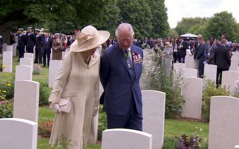 Prince Charles and Camilla walk amongst the graves - Credit: BBC
