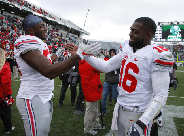 Ohio State's J.T. Barrett, right, is back for his senior season. (AP Photo/Al Goldis, File)