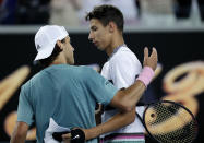 France's Lucas Pouille, left, is congratulated by Australia's Alexei Popyrin after winning their third round match at the Australian Open tennis championships in Melbourne, Australia, Sunday, Jan. 20, 2019. (AP Photo/Kin Cheung)