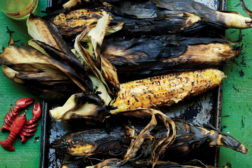 "Grilling corn in its husk protects the kernels and lets them steam—though they still get a nice charred flavor from the grill. Plus, they're easy to make, so you can concentrate on the <a href=""https://www.epicurious.com/recipes-menus/best-burger-hamburger-recipes-memorial-day-barbecue-cookout-gallery?mbid=synd_yahoo_rss"" rel=""nofollow noopener"" target=""_blank"" data-ylk=""slk:burgers"" class=""link rapid-noclick-resp"">burgers</a>. <a href=""https://www.epicurious.com/recipes/food/views/whole-corn-on-the-grill?mbid=synd_yahoo_rss"" rel=""nofollow noopener"" target=""_blank"" data-ylk=""slk:See recipe."" class=""link rapid-noclick-resp"">See recipe.</a>"