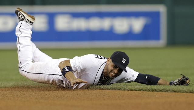 Detroit Tigers second baseman Omar Infante dives but can't field a ground ball hit by Oakland Athletics' Alberto Callaspo in the fifth inning of a baseball game in Detroit, Wednesday, Aug. 28, 2013. The Athletics' Brandon Moss scored on the play. (AP Photo/Paul Sancya)