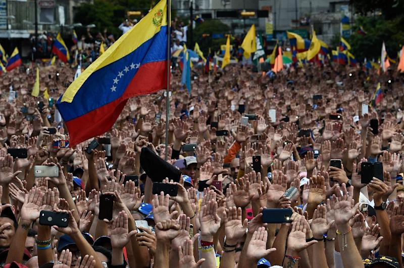 Demonstrators in Caracas rally against Nicolas Maduro, who the United States has declared to be illegimate as the president of Venezuela (AFP Photo/Federico PARRA)