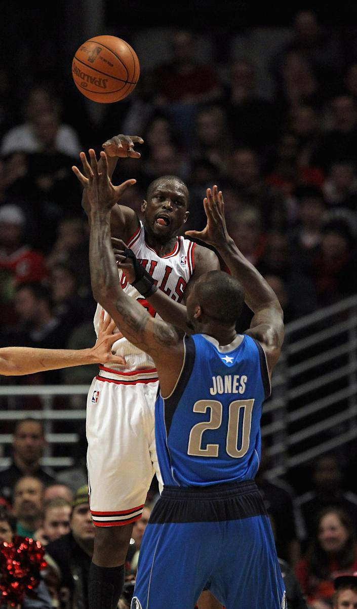 CHICAGO, IL - APRIL 21: Loul Deng #9 of the Chicago Bulls passes over Dominique James #20 of the Dallas Mavericks at the United Center on April 21, 2012 in Chicago, Illinois. NOTE TO USER: User expressly acknowledges and agress that, by downloading and/or using this photograph, User is consenting to the terms and conditions of the Getty Images License Agreement. (Photo by Jonathan Daniel/Getty Images)