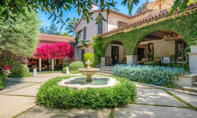 "Built in 1927, the Spanish-style mansion includes a guesthouse, courtyard, pavilion, basketball court, tennis court, pool, spa and rose garden. <span class=""copyright"">(Realtor.com)</span>"